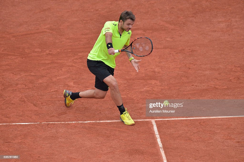 <a gi-track='captionPersonalityLinkClicked' href=/galleries/search?phrase=Stanislas+Wawrinka&family=editorial&specificpeople=557155 ng-click='$event.stopPropagation()'>Stanislas Wawrinka</a> of Switzerland plays a backhand during his men's singles fourth round match against Viktor Troicki of Serbia on day eight of the 2016 French Open at Roland Garros on May 29, 2016 in Paris, France.