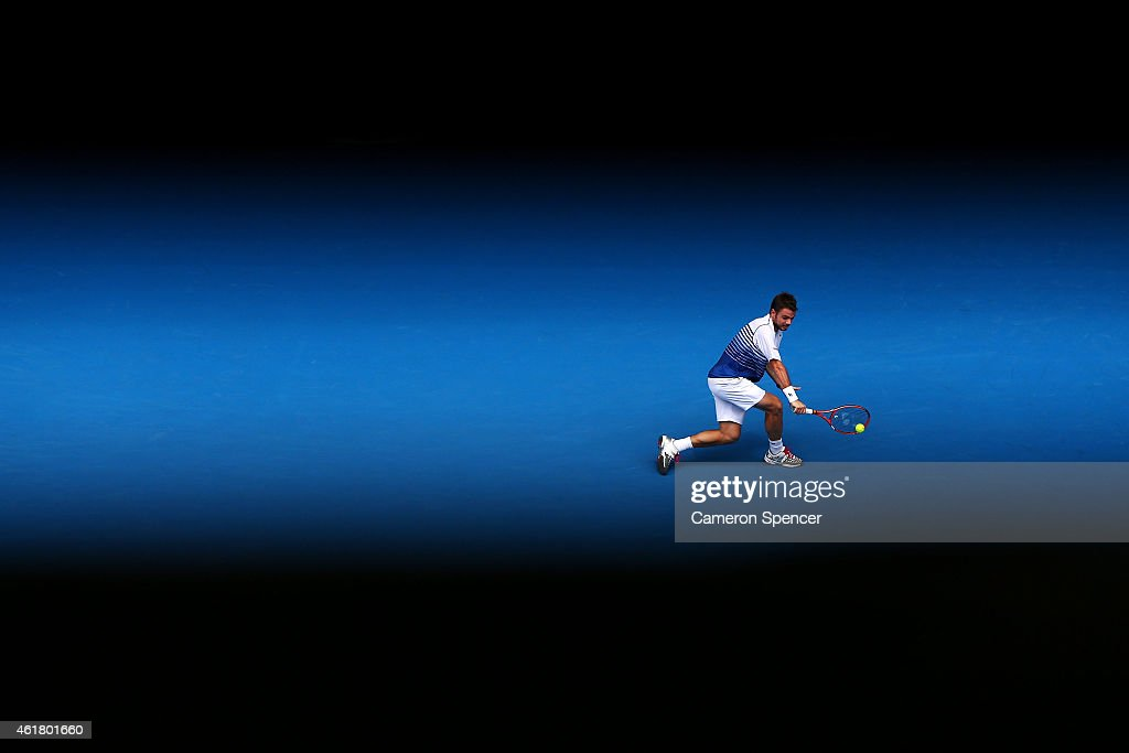 Stanislas Wawrinka of Switzerland plays a backhand in his first round match against Marsel Ilhan of Turkey during day two of the 2015 Australian Open...