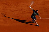 Stanislas Wawrinka of Switzerland plays a backhand in his match against Rafael Nadal of Spain during day six of the ATP Monte Carlo Masters on April...