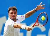 Stanislas Wawrinka of Switzerland plays a backhand in his men's singles second round match against Kevin Anderson of South Africa during day three of...