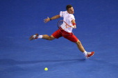 Stanislas Wawrinka of Switzerland plays a backhand in his semifinal match against Tomas Berdych of the Czech Republic during day 11 of the 2014...
