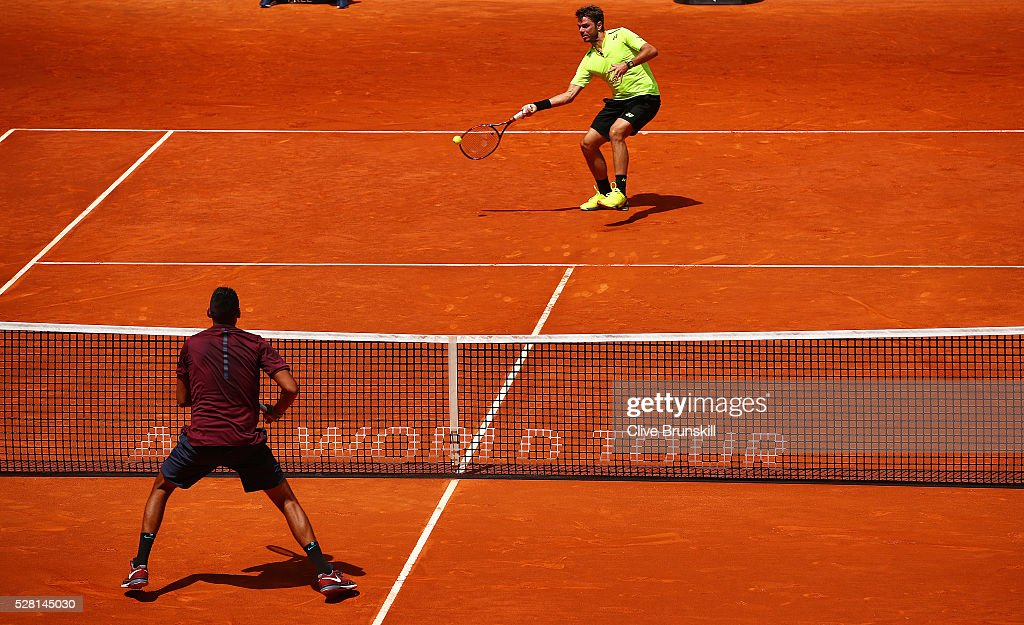 <a gi-track='captionPersonalityLinkClicked' href=/galleries/search?phrase=Stanislas+Wawrinka&family=editorial&specificpeople=557155 ng-click='$event.stopPropagation()'>Stanislas Wawrinka</a> of Switzerland plays a forehand during his straight sets defeat against <a gi-track='captionPersonalityLinkClicked' href=/galleries/search?phrase=Nick+Kyrgios&family=editorial&specificpeople=6705178 ng-click='$event.stopPropagation()'>Nick Kyrgios</a> of Australia in their second round match during day five of the Mutua Madrid Open tennis tournament at the Caja Magica on May 04, 2016 in Madrid.