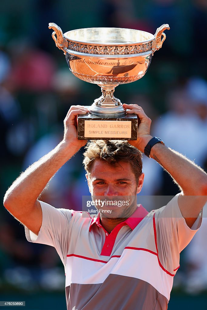 Stanislas Wawrinka of Switzerland poses with the Coupe de Mousquetaires after victory in the Men's Singles Final against Novak Djokovic of Serbia on day fifteen of the 2015 French Open at Roland Garros on June 7, 2015 in Paris, France.