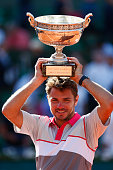 Stanislas Wawrinka of Switzerland poses with the Coupe de Mousquetaires after victory in the Men's Singles Final against Novak Djokovic of Serbia on...