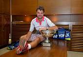 Stanislas Wawrinka of Switzerland poses with the Coupe de Mousquetaires after victory in his changing room after the Men's Singles Final against...
