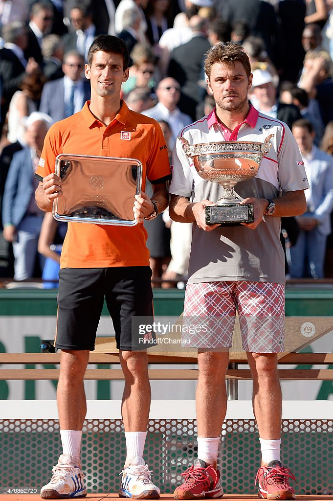 Stanislas Wawrinka (R) of Switzerland poses with the Coupe de Mousquetaires after victory in the Men's Singles Final against Novak Djokovic (L) of Serbia on day fifteen of the 2015 French Open at Roland Garros on June 7, 2015 in Paris, France.