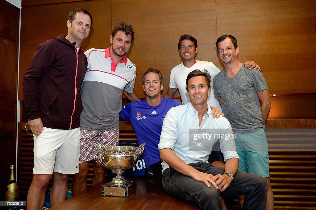 <a gi-track='captionPersonalityLinkClicked' href=/galleries/search?phrase=Stanislas+Wawrinka&family=editorial&specificpeople=557155 ng-click='$event.stopPropagation()'>Stanislas Wawrinka</a> of Switzerland (2L) poses with the Coupe de Mousquetaires and coaches Severin Luthi (L), Magnus Norman (C) and agent Lawrence Frankopan (front) after victory in his changing room after the Men's Singles Final against Novak Djokovic of Serbia on day fifteen of the 2015 French Open at Roland Garros on June 7, 2015 in Paris, France.
