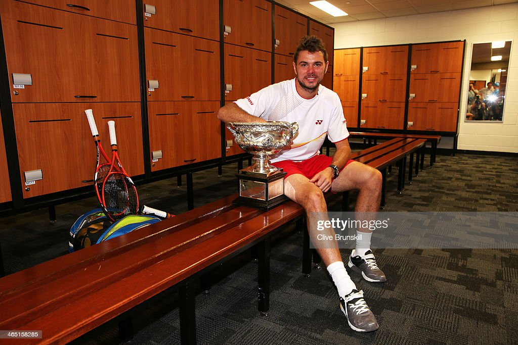 <a gi-track='captionPersonalityLinkClicked' href=/galleries/search?phrase=Stanislas+Wawrinka&family=editorial&specificpeople=557155 ng-click='$event.stopPropagation()'>Stanislas Wawrinka</a> of Switzerland poses with the Norman Brookes Challenge Cup in the players dressing room after winning his men's final match against Rafael Nadal of Spain during day 14 of the 2014 Australian Open at Melbourne Park on January 26, 2014 in Melbourne, Australia.