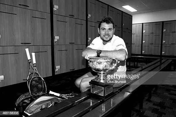 Stanislas Wawrinka of Switzerland poses with the Norman Brookes Challenge Cup in the players dressing room after winning his men's final match...