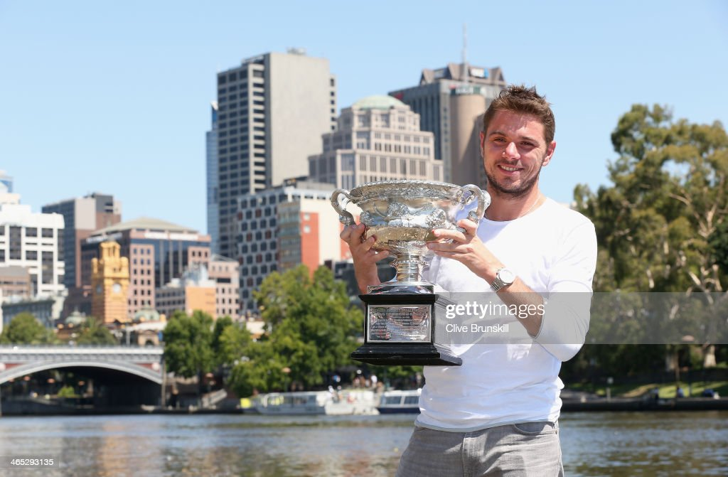 <a gi-track='captionPersonalityLinkClicked' href=/galleries/search?phrase=Stanislas+Wawrinka&family=editorial&specificpeople=557155 ng-click='$event.stopPropagation()'>Stanislas Wawrinka</a> of Switzerland poses with the Norman Brookes Challenge Cup at Melbourne University Boat Club, after winning the 2014 Australian Open, on January 27, 2014 in Melbourne, Australia.