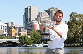 Stanislas Wawrinka of Switzerland poses with the Norman Brookes Challenge Cup at Melbourne University Boat Club after winning the 2014 Australian...