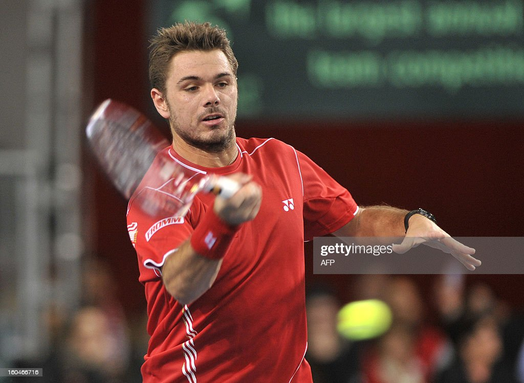 Stanislas Wawrinka of Switzerland return a ball to Lukas Rosol of Czech Republic during a Davis Cup World Group first round game between Switzerland and the Czech Republic on February 1, 2013 in Geneva. FEVAL