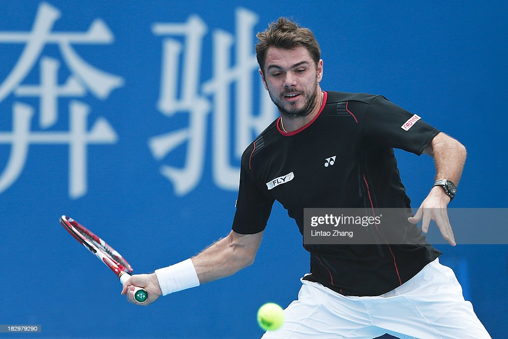 Stanislas Wawrinka of Switzerland returns a shot during his men's singles match against Sam Querrey of the United States on day six of the 2013 China Open at the National Tennis Center on October 3, 2013 in Beijing, China.