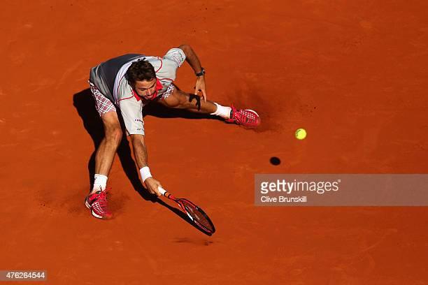 Stanislas Wawrinka of Switzerland returns a shot in the Men's Singles Final against Novak Djokovic of Serbia on day fifteen of the 2015 French Open...