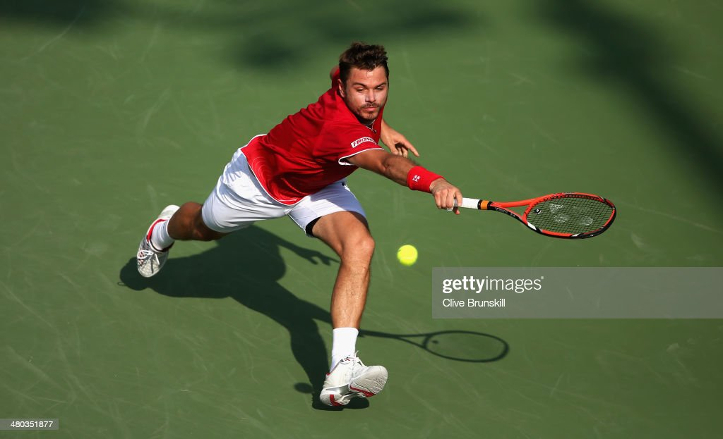 Stanislas Wawrinka of Switzerland runs to play a backhand against Edouard Roger-Vasselin of France during their third round match during day 8 at the Sony Open at Crandon Park Tennis Center on March 24, 2014 in Key Biscayne, Florida.