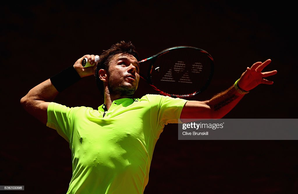 <a gi-track='captionPersonalityLinkClicked' href=/galleries/search?phrase=Stanislas+Wawrinka&family=editorial&specificpeople=557155 ng-click='$event.stopPropagation()'>Stanislas Wawrinka</a> of Switzerland serves against Nick Kyrgios of Australia in their second round match during day five of the Mutua Madrid Open tennis tournament at the Caja Magica on May 04, 2016 in Madrid.