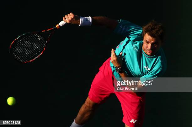 Stanislas Wawrinka of Switzerland serves against Philipp Kohlschreiber of Germany in their third round match during day eight of the BNP Paribas Open...
