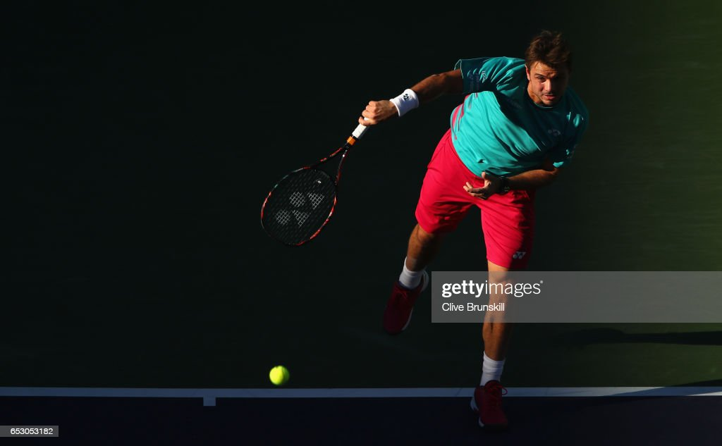 Stanislas Wawrinka of Switzerland serves against Philipp Kohlschreiber of Germany in their third round match during day eight of the BNP Paribas Open at Indian Wells Tennis Garden on March 13, 2017 in Indian Wells, California.