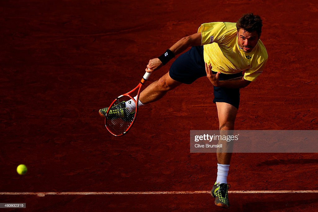 Stanislas Wawrinka of Switzerland serves during his men's singles match against Guillermo Garcia-Lopez of Spain on day two of the French Open at Roland Garros on May 26, 2014 in Paris, France.