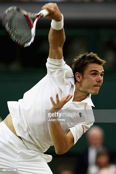 Stanislas Wawrinka of Switzerland serves during the men's singles fourth round match against Andy Murray of Great Britain on Day Seven of the...