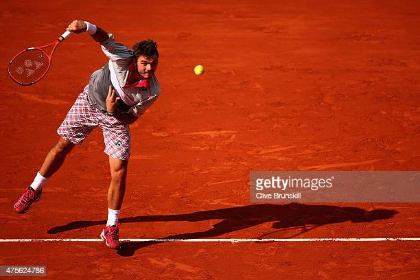 Stanislas Wawrinka of Switzerland serves in his Men's quarter final match against Roger Federer of Switzerland on day of the 2015 French Open at...