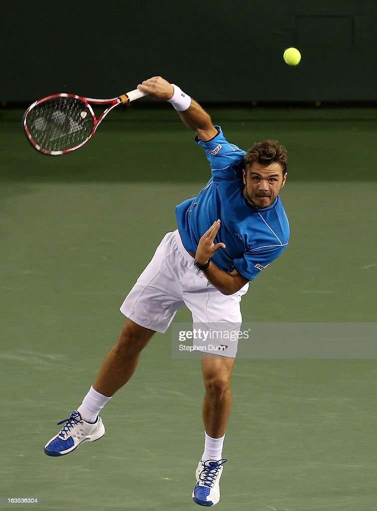 Stanislas Wawrinka of Switzerland serves to Lleyton Hewitt of Australia during day 6 of the BNP Paribas Open at Indian Wells Tennis Garden on March 11, 2013 in Indian Wells, California. (Photo by Stephen Dunn/Getty Images).