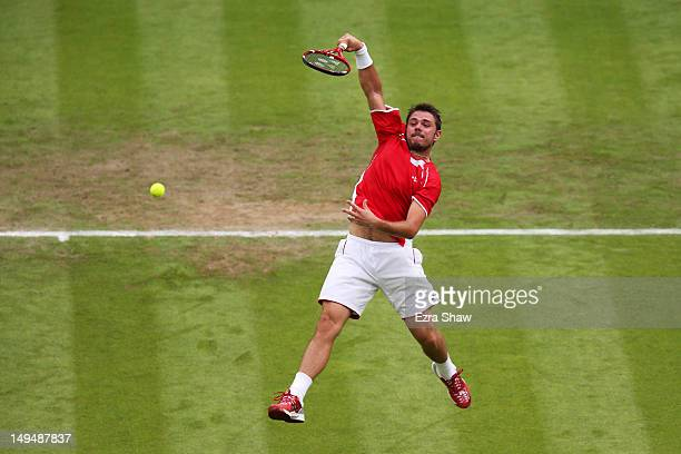 Stanislas Wawrinka of Switzerland smashes the ball during the Men's Singles Tennis match against Andy Murray of Great Britain on Day 2 of the London...