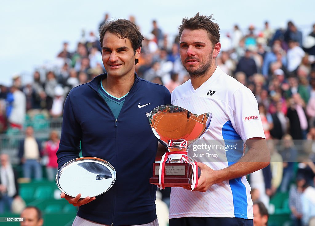 Stanislas Wawrinka of Switzerland with the winners trophy along side runner up Roger Federer of Switzerland in the final during day eight of the ATP...
