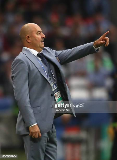 Stanislav Cherchesov head coach of Russia gives instruction during the FIFA Confederations Cup Russia 2017 Group A match between Mexico and Russia at...