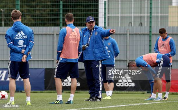 Stanislav Cherchesov head coach of Russia gives instructions to his team during a training session at Novogorsk Training Center during a media tour...