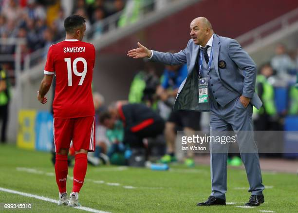Stanislav Cherchesov head coach of Russia speaks to Alexander Samedov of Russia during the FIFA Confederations Cup Russia 2017 Group A match between...