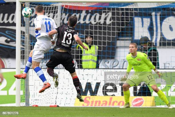 Stanislav Iljutcenko of MSV Duisburg Peter Kurzweg and Jakob Busk of 1 FC Union Berlin during the game between MSV Duisburg and 1 FC Union Berlin on...