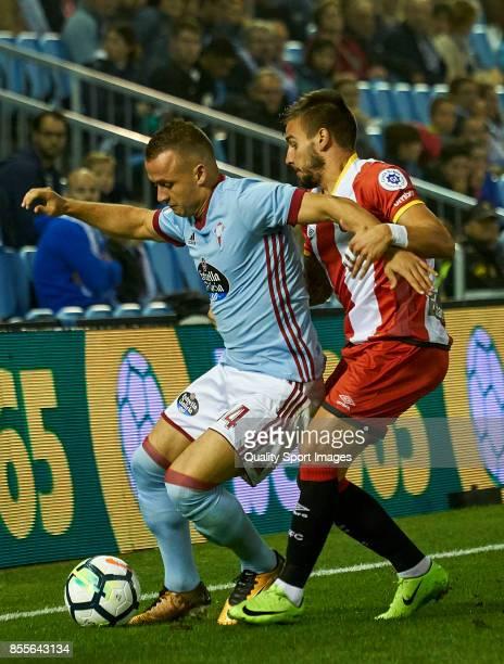 Stanislav Lobotka of Celta de Vigo is challenged by Cristian Portugues 'Portu' of Girona FC during the La Liga match between Celta de Vigo and Girona...