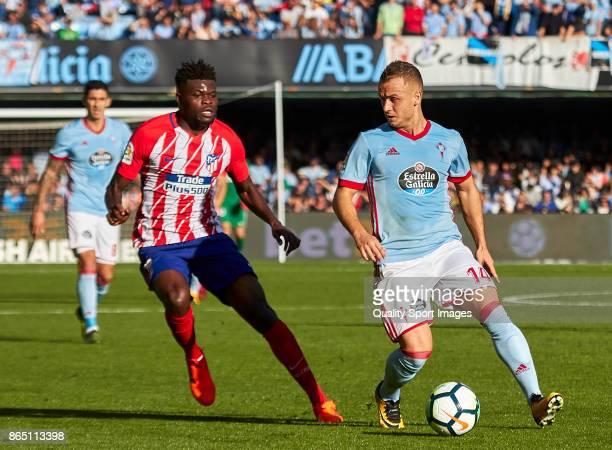Stanislav Lobotka of Celta de Vigo is challenged byaThomas Teye Partey of Atletico de Madrid during the La Liga match between Celta de Vigo and...