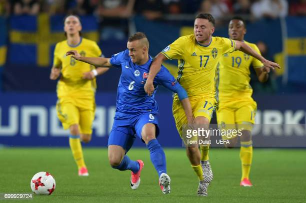 Stanislav Lobotka of Slovakia and Kerim Mrabti of Sweden battle for possession during the UEFA European Under21 Championship Group A match between...