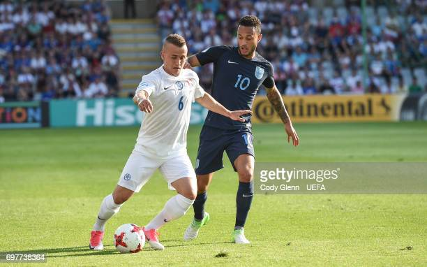 Stanislav Lobotka of Slovakia and Lewis Baker of England during their UEFA European Under21 Championship match on June 19 2017 in Kielce Poland
