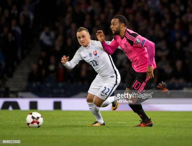 Stanislav Lobotka of Slovakia and Matt Phillips of Scotland compete for the ball during the match between Scotland and Slovakia at Hampden Park on...