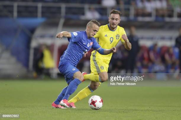 Stanislav Lobotka of Slovakia and Muamer Tankovic of Sweden competes for the ball during the UEFA European Under21 match between Slovakia and Sweden...