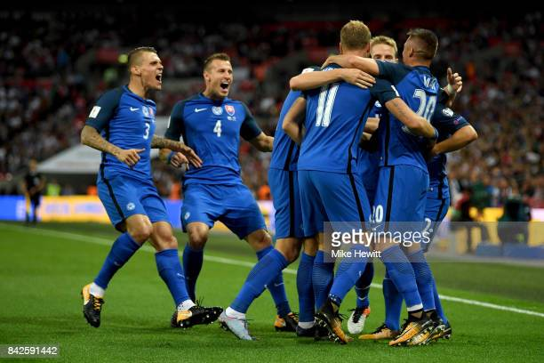 Stanislav Lobotka of Slovakia celebrates as he scores their first goal with team mates during the FIFA 2018 World Cup Qualifier between England and...