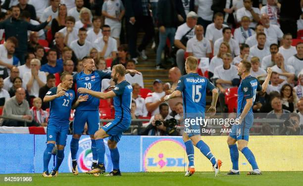 Stanislav Lobotka of Slovakia celebrates with his team mates after scoring a goal to make it 01 during the FIFA 2018 World Cup Qualifier between...