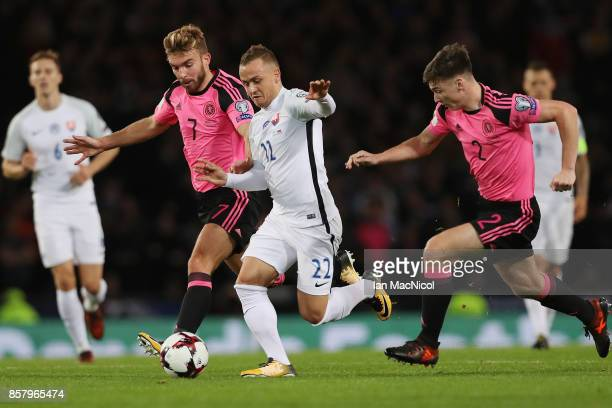 Stanislav Lobotka of Slovakia goes between James Morrison and Kieran Tierney of Scotland during the FIFA 2018 World Cup Group F Qualifier between...