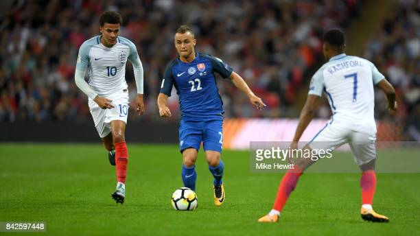Stanislav Lobotka of Slovakia is watched by Dele Alli and Marcus Rashford of England during the FIFA 2018 World Cup Qualifier between England and...