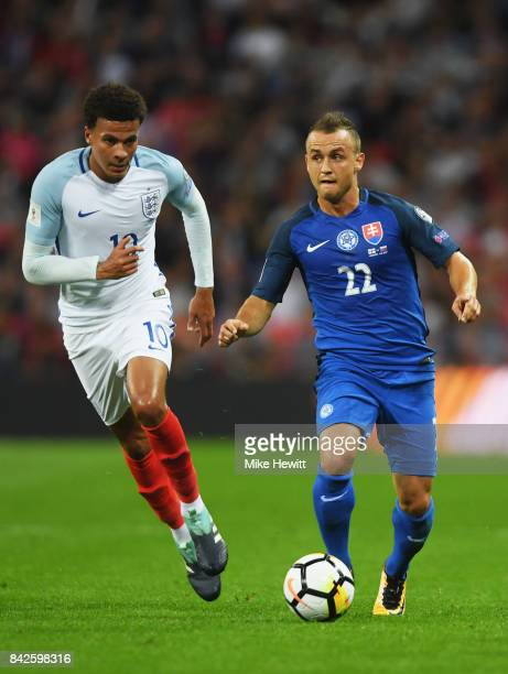 Stanislav Lobotka of Slovakia is watched by Dele Alli of England during the FIFA 2018 World Cup Qualifier between England and Slovakia at Wembley...
