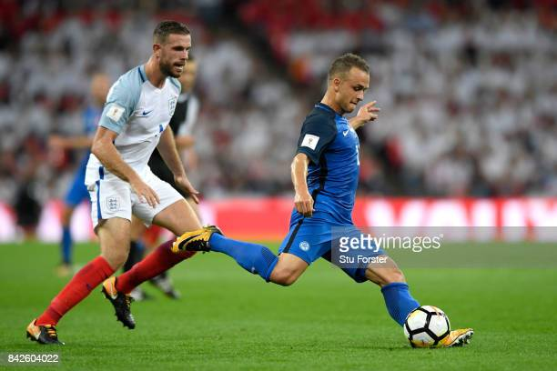 Stanislav Lobotka of Slovakia is watched by Jordan Henderson of England during the FIFA 2018 World Cup Qualifier between England and Slovakia at...