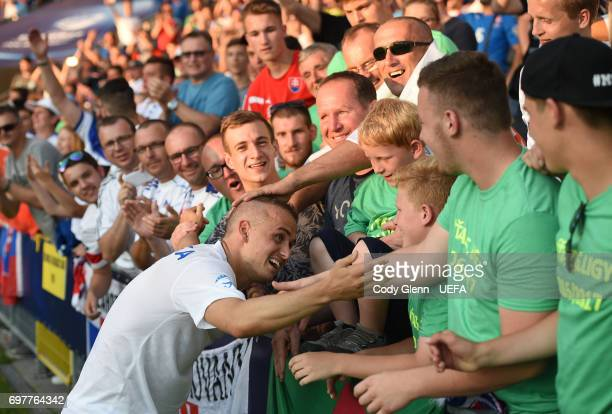 Stanislav Lobotka of Slovakia poses with supporters after their UEFA European Under21 Championship match against England on June 19 2017 in Kielce...