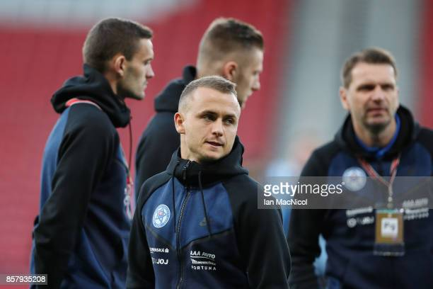 Stanislav Lobotka of Slovakia stands on the pitch with team mates prior to the FIFA 2018 World Cup Group F Qualifier between Scotland and Slovakia at...