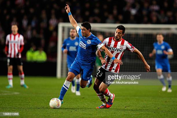 Stanislav Manolev of PSV and Victor Giuliano of Dnipro battle for the ball during the UEFA Europa League Group F match between PSV Eindhoven and FC...