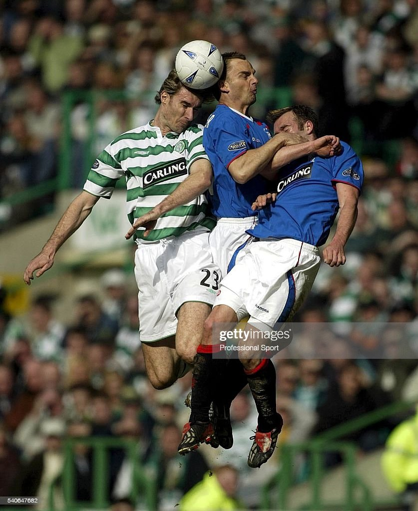 Stanislav Varga of Celtic (left) beats <a gi-track='captionPersonalityLinkClicked' href=/galleries/search?phrase=Ronald+De+Boer&family=editorial&specificpeople=1006743 ng-click='$event.stopPropagation()'>Ronald De Boer</a> and <a gi-track='captionPersonalityLinkClicked' href=/galleries/search?phrase=Fernando+Ricksen&family=editorial&specificpeople=4278442 ng-click='$event.stopPropagation()'>Fernando Ricksen</a> of Rangers to the ball during the Scottish Premier League quarter-final match between Rangers and Celtic at Ibrox Stadium on March 28, 2004 in Glasgow, Scotland.