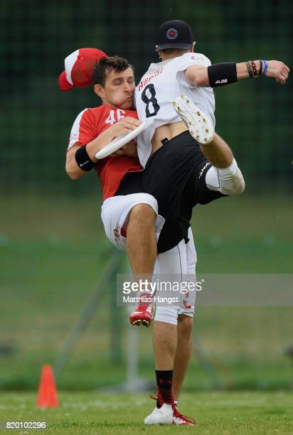 Stanislaw Boguslawski R Poland catches the frisbee against Morgan Hibbert of Canada during the Ultimate Mixed Flying Disc Qualification match between...