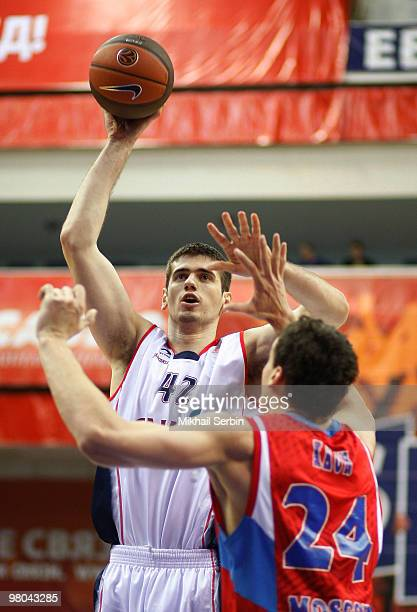 Stanko Barac of Caja Laboral competes with Sasha Kaun of CSKA Moscow during the Euroleague Basketball 20092010 Play Off Game 2 between CSKA Moscow vs...